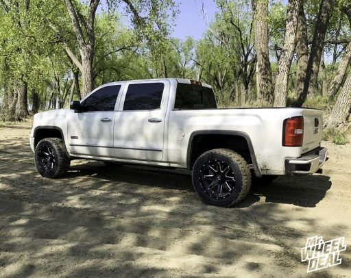 Black Milled 20x10 -19mm Hostile Alpha wheels with LT285/55R20 Toyo Open Country RT tires on a 2015 GMC Sierra 1500