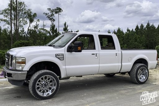 2010 Ford F-250 with 22x12 Vision Rocker -51mm Chrome wheels and 33x12.50R22LT Toyo Open Country MT tires
