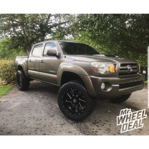 20x10 Hostile Stryker -19mm Black Milled wheels with LT285/55R20 AMP Terrain Gripper AT G tires on a 2010 Toyota Tacoma+mm