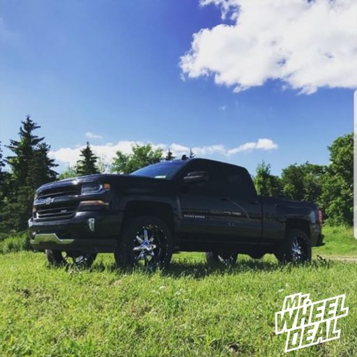 2016 Chevy Silverado 1500 with 22x10 Chrome and Black Moto Metal 201 -18mm wheels and 305/45R22 Nitto NT420S tires