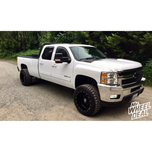 2012 Chevy Silverado 2500HD with Black 20x12 Hostile Sprocket wheels and LT305/55R20 Toyo Open Country RT tires