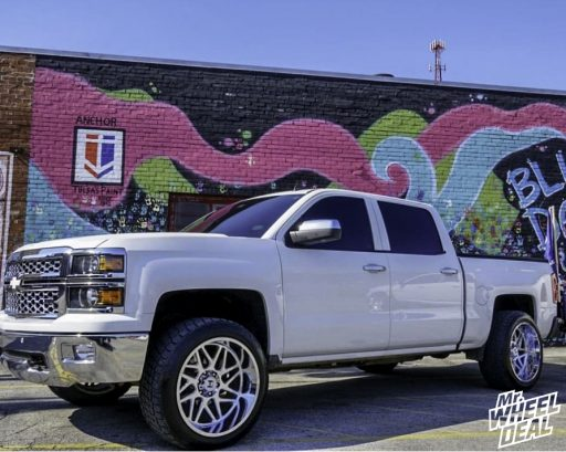 "2014 Chevy Silverado 1500 with 22x12"" -44mm Chrome Hostile Sprocket wheels and 305/45R22XL Nitto Terra Grappler G2 tires"