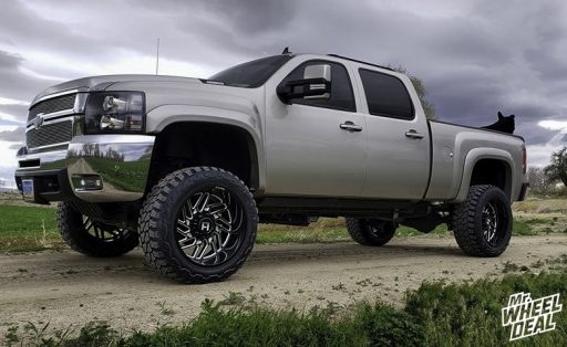 """22x12"""" -44mm Black Milled Hostile Jigsaw wheels with 35x13.50R22 Fury Offroad Country Hunter MT tires on a 2008 Chevy Silverado 2500HD"""