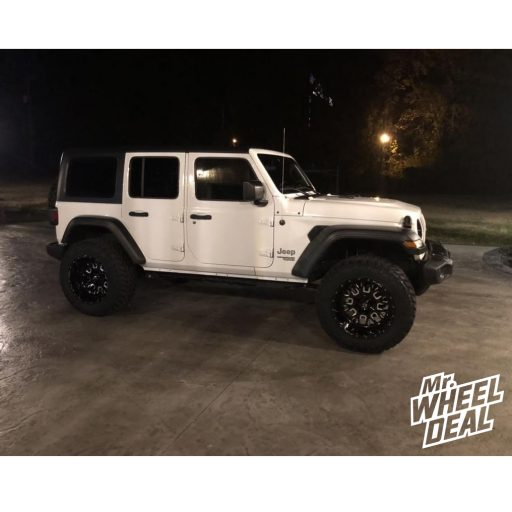 """20x12"""" Fuel Off-Road Stroke -43mm Black Milled wheels with 35x12.50R20LT Nitto Trail Grappler tires on a 2018 Jeep Wrangler Unlimited"""