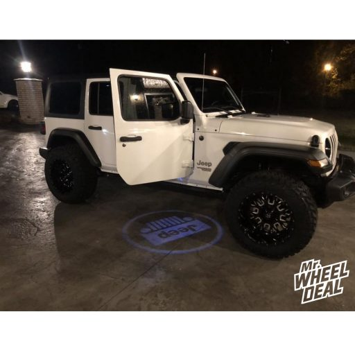 """2018 Jeep Wrangler Unlimited with 20x12"""" Fuel Off-Road Stroke -43mm Black Milled wheels and 35x12.50R20LT Nitto Trail Grappler tires"""