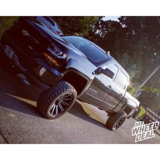 2017 Chevy Silverado 1500 with 22x10 Fuel Contra -18mm Black Milled wheels with LT325/50R22 Mickey Thompson Baja ATZ P3 tires