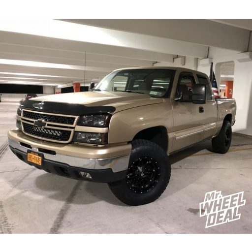 17x9 Fuel Off-Road Hostage -12mm Black wheels with 285/70R17 Nitto Terra Grappler G2 tires on a 2006 Chevy Silverado 1500
