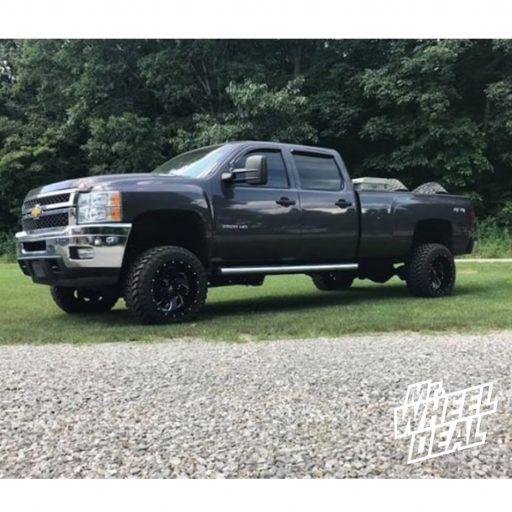 2011 Chevy Silverado 2500HD with 20x12 Black Milled Fuel Cleaver wheels and 33X12.5R20LT Atturo Trail Blade MT tires