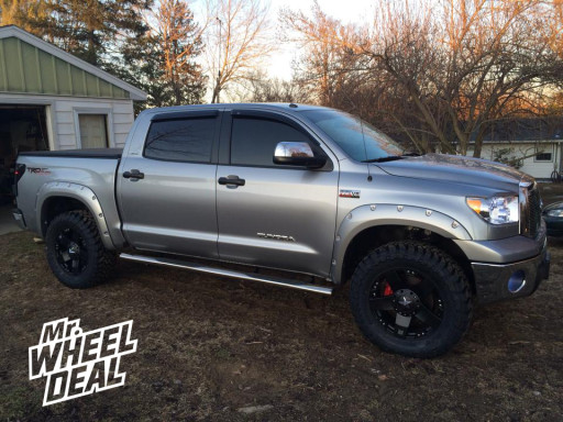 """20x8.5"""" XD Rockstar Black Wheels with 35x12.50x20 Toyo Open Country MT Tires on a 2011 Toyota Tundra"""