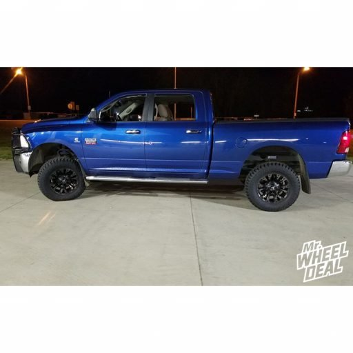 """18x9"""" Black Flake Fuel Off-Road Vapor -12mm wheels with 33x12.50R18LT Fury Offroad Country Hunter RT tires on a 2011 Ram 2500"""
