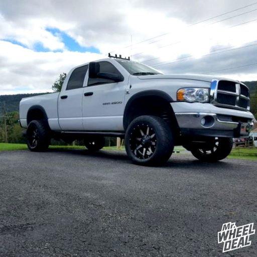 2003 Dodge Ram 2500 with 20x10 Fuel Off-Road Maverick -24mm Machined Black wheels and 305/50R20 Nitto NT420S tires
