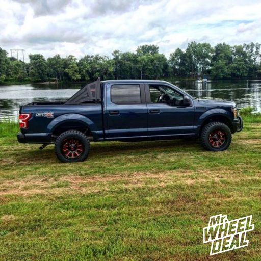 """20x10"""" Fuel Off-Road Hardline Black Red wheels with 33X12.50R20/10 Ironman All Country MT tires on a 2018 Ford F-150"""