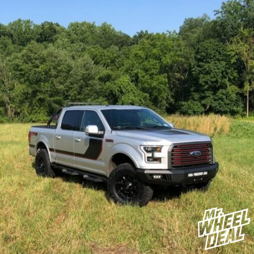 2016 Ford F-150 with Gloss Black 18x9 Fuel Offroad Coupler wheels and 35x12.50R18LT Nitto Ridge Grappler tires