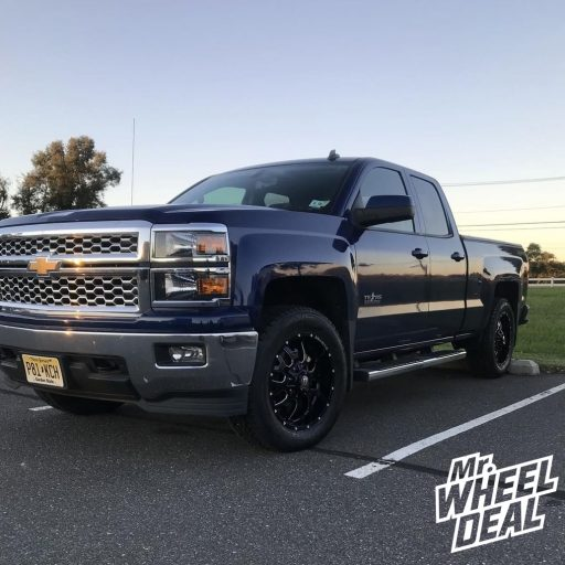 """20x9"""" Black Ballistic Tank 12mm wheels with 275/60R20 Nokian Rotiiva AT tires on a 2014 Chevy Silverado 1500"""