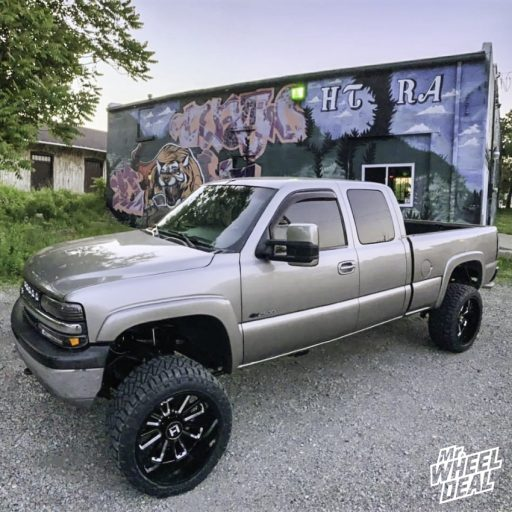 22x12 -44mm Black Milled Hostile Predator wheels with 33x12.5R22LT Nitto Ridge Grappler tires on a 2002 Chevy Silverado 2500