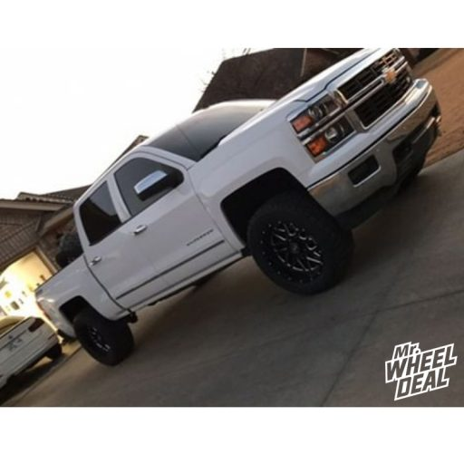 """20x10"""" Hostile Sprocket -19mm Black Milled wheels with 33x12.50R20LT Toyo Open Country RT tires on a 2014 Chevy Silverado 1500"""