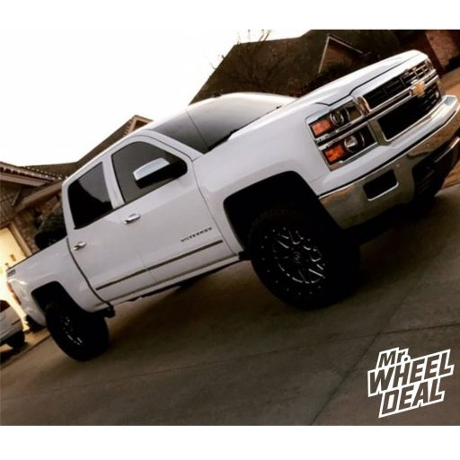 """20x10"""" Black Milled Hostile Sprocket -19mm wheels with 33x12.50R20LT Toyo Open Country RT tires on a 2014 Chevy Silverado 1500"""
