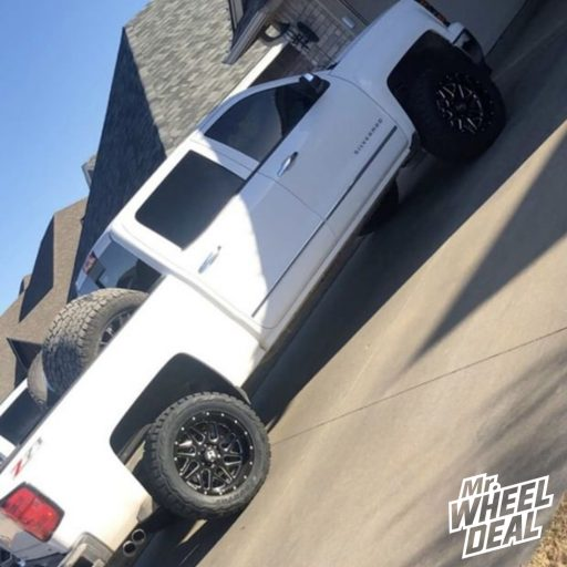 2014 Chevy Silverado 1500 with 20x10 Hostile Sprocket -19mm Black Milled wheels and 33x12.50R20LT Toyo Open Country RT tires