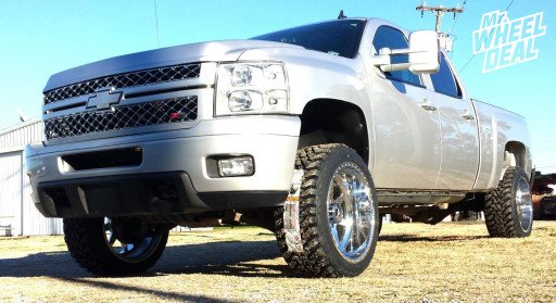 """22x12"""" American Force Independence Polished Wheels with 33x12.50x22 Toyo Open Country MT Tires on a 2010 Chevy Silverado 2500HD"""