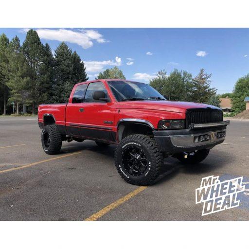 "18x10"" Moto Metal MO970 Black Milled wheels with LT295/70R18 Cooper Discoverer STT Pro tires on a 2001 Dodge Ram 2500"