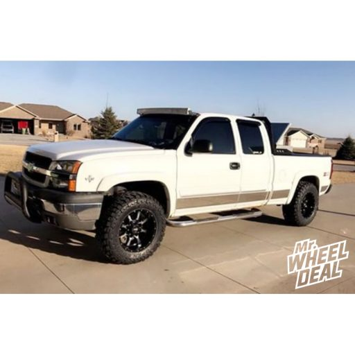 """2004 Chevy Silverado 1500 with 18x10"""" Moto Metal 970 -24mm Black wheels with 33X12.50R18LT Toyo Open Country MT tires"""