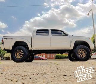 2014 Toyota Tacoma with Bronze Black 17x9 Raceline Defender wheels and LT35X12.5R17 Federal Couragia MT tires
