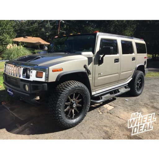 "20x9"" Raceline Shift 12mm Black Tint wheels with LT37X12.50R20 AMP Terrain Gripper AT G tires on a 2003 Hummer H2"