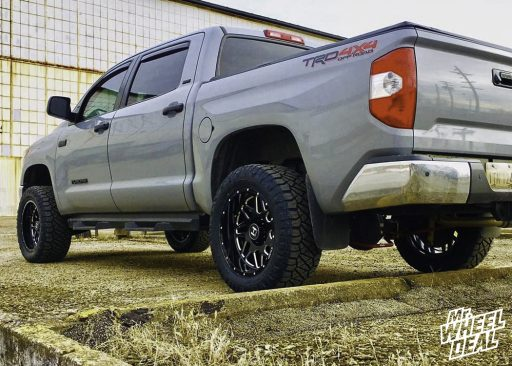 20x10 -19mm Black Milled Hostile Sprocket wheels with 305/55R20 Nitto Ridge Grappler tires on a 2018 Toyota Tundra