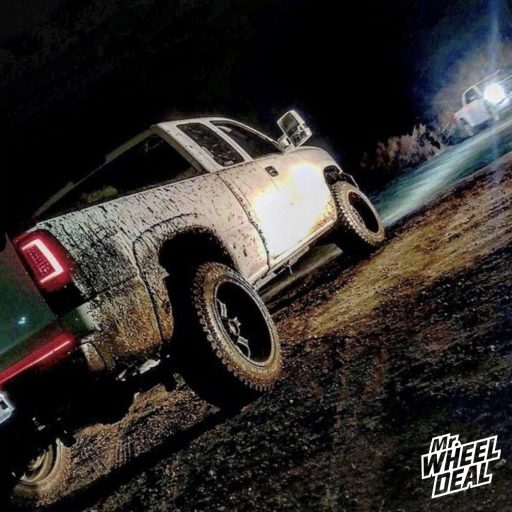 "2005 Chevy Silverado 1500 with 20x12"" Red Dirt Road Dirt -44mm Black Machined wheels and 33x12.50R20LT Atturo Trail Blade XT tires"