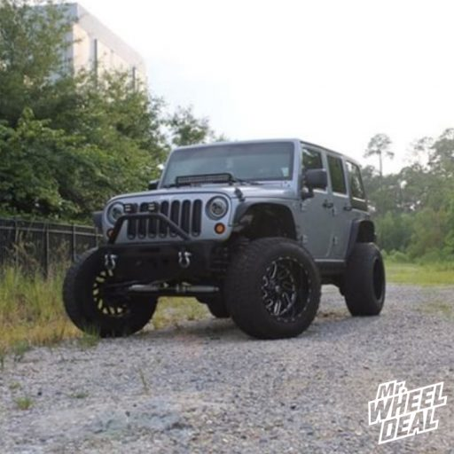 2013 Jeep Wrangler Sport with 20x12 Black Milled Fuel Triton wheels with 35x12.50R20LT Nitto Terra Grappler G2 tires