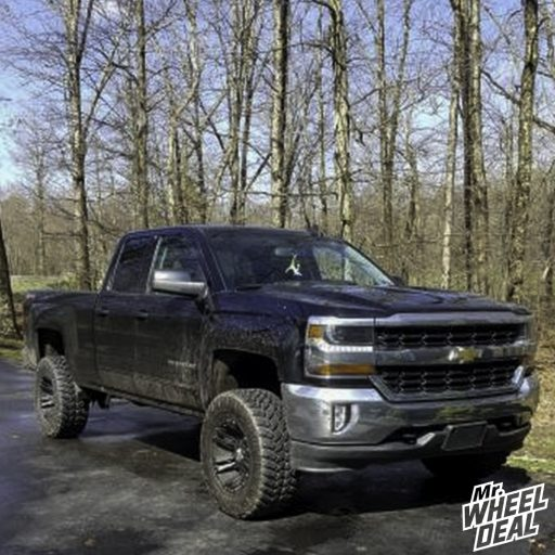 2016 Chevy Silverado 1500 with 18x10 -24mm Black XD822 wheels and 33x12.50R18LT Nitto Trail Grappler tires