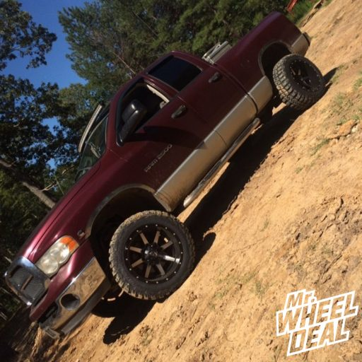 """20x12"""" Fuel Offroad Maverick Machined Black wheels with LT33X12.5R20 Federal Couragia MT tires on a 2003 Ram 2500"""
