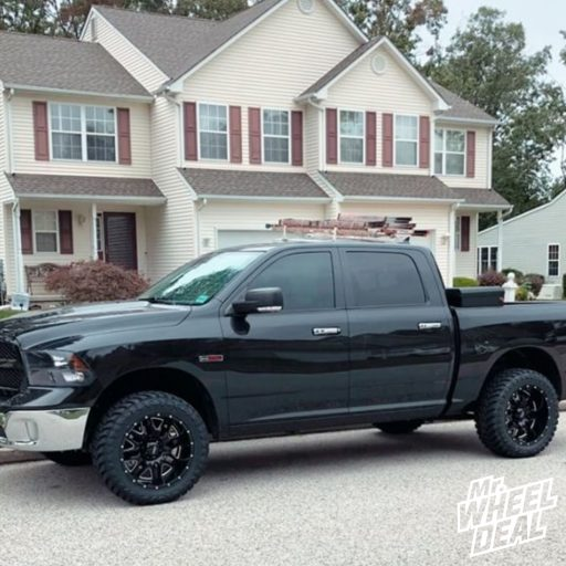 "2016 Ram 1500 with 20x10"" Black Milled Ultra Hunter -25mm wheels and 33X12.5R20LT Atturo Trail Blade MT tires"