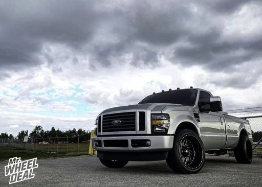 2010 Ford F-250 with 22x12 -43mm Black Milled Fuel Triton wheels and 305/40R22 Nitto NT420S tires