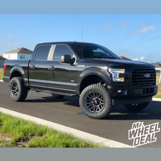 "20x10"" Fuel Off-Road Warrior -18mm Black Milled wheels with LT35X12.50R20 AMP Terrain Gripper AT G tires on a 2017 Ford F150"
