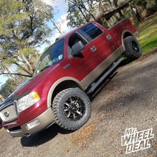 2005 Ford F150 with 18x10 Black and Milled Moto Metal 970 wheels and 33x12.50R18 Toyo Open Country MT tires