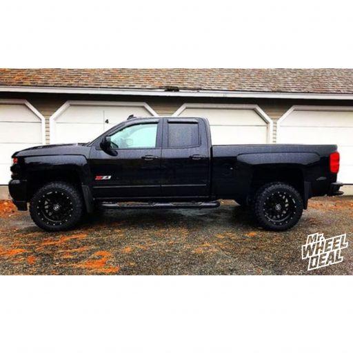 """20x10"""" Black Hostile Sprocket -19mm wheels with 33x12.5R20LT Atturo Trail Blade MT tires on a 2017 Chevy Silverado 1500"""