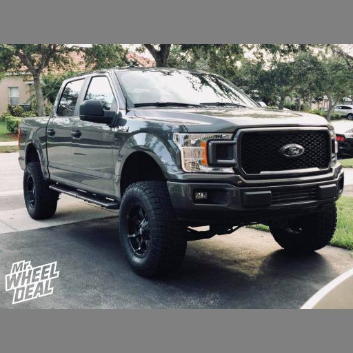 18x9 Fuel Offroad Coupler -12mm Black wheels with 35x12.50R18LT Nitto Terra Grappler G2 tires on a 2018 Ford F150