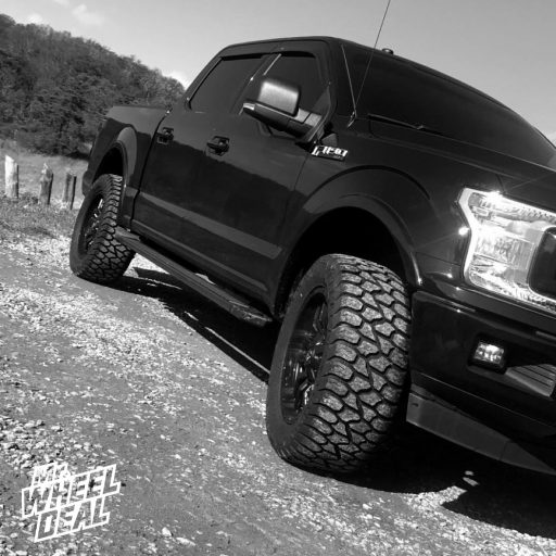 20x9 Fuel Sledge Matte Black wheels with LT305/55R20 AMP Terrain Gripper AT G tires on a 2018 Ford F150