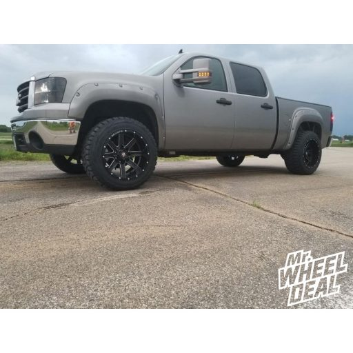 2007 GMC Sierra 1500 with 20x12 Ballistic Rage Black wheels and LT295/55R20 Toyo Open Country RT tires