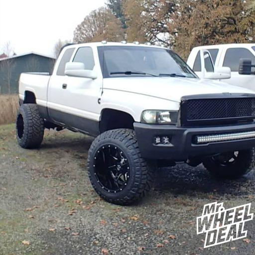 2001 Dodge Ram 2500 with 20x14 Fuel Off-Road Maverick -76mm Black Milled wheels and 35x13.5R20LT Nitto Ridge Grappler tires