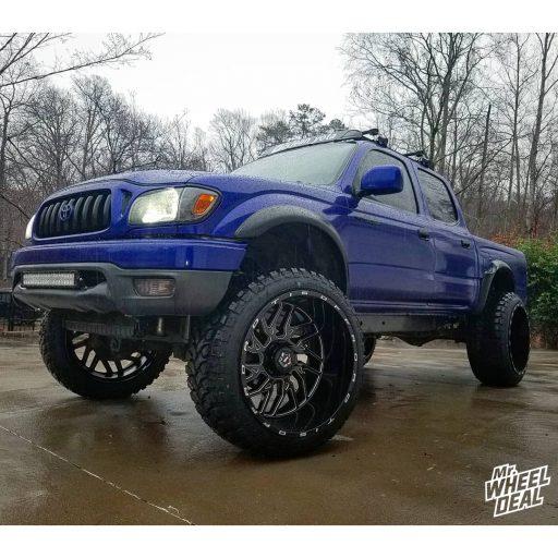24x14 Black Milled TIS 544BM -76mm wheels with 35x12.50R24LT RBP Repulsor MT tires on a 2002 Toyota Tacoma