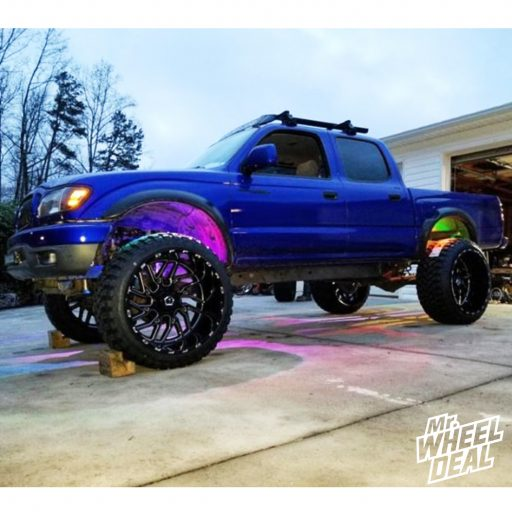 2002 Toyota Tacoma with 24x14 TIS 544BM -76mm Black Milled wheels and 35x12.50R24LT RBP Repulsor MT tires
